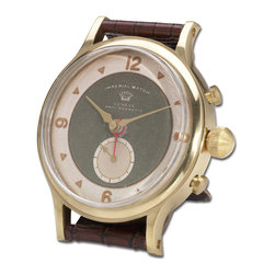 Uttermost - Wristwatch Alarm Round Imperial - Wristwatch Alarm Round Imperial by Uttermost. Brass rim with leather stand. Requires 1-AA battery.