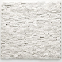 Glass Tile Oasis - Beaux Unique Shapes White Modern Series Tumbled Natural Stone - During manufacturing, the tiles are hand sorted into matching colors and sizes and individually glued onto mesh backing. It is not unusual to find occasional imperfections, veins and lines of separation within the stones.