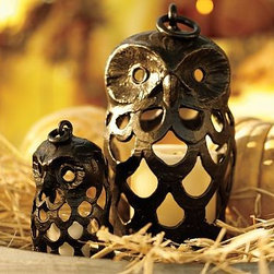 """Owl Shaped Lantern, Large, Bronze finish - Destined to light Halloween nights for years to come, our Bronze Owls are perfect for hanging on the front porch or along the walkway. Place a candle inside and they will greet trick-or-treaters with glowing eyes. Small: 4"""" diameter, 7"""" high Large: 7"""" diameter, 12"""" high Made of aluminum with a bronze finish."""
