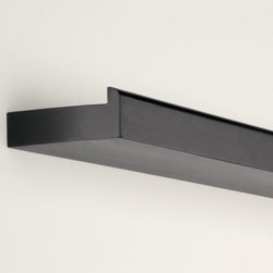 """Exposures - Haley 48"""" Floating Display Ledge - Overview This simple Haley 48"""" floating shelf is an surprising way to surround yourself with photos, artwork and other cherished items. Our floating shelf is 3 1/2"""" deep, with just enough lip to prevent slipping or sliding.  Features Made from solid wood Available in either black or white Includes hanging template and hardware Specifications Ledge measures  4'W x 3-1/2""""D Shipping   No Air Express available"""