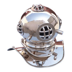 Handcrafted Nautical Decor - Chrome Divers Helmet 9'' - The Chrome Divers Helmet 9'' is a perfect  accent for any nautical themed room; the polished chrome finish adds a classy nautical feel not found in all diving helmet replicas. The miniature  reproduction of an original U.S. Navy Mark V deep-sea diving helmet is  constructed of solid, highly polished, heavy-duty chrome and  features 4 viewing holes, helmet rivets, and replica latches. Place this  beautifully crafted diving helmet on a desk, table, or shelf in any  home or office to add a lovely conversation piece that no nautical Decor  collection is complete without.--------    Handcrafted from solid polished chrome --    Classic nautical decor--    Polished chrome grills and fittings----