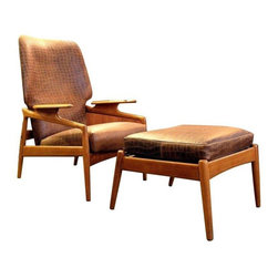 Pre-owned Danish Modern Lounge Chair with Ottoman - A beautifully crafted Danish Modern lounge chair and ottoman set. This set is in good condition with well-worn patinated crocodile patterned leather. The chair features characteristic Scandinavian rounded wood detailing that creates the frame and base and continues flowing upwards resulting in beautiful wood armrests.