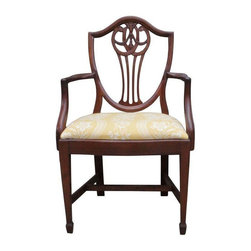 Pre-owned Victorian Hepplewhite Arm Chair - This Victorian, Hepplewhite style armchair with shield back gives any room a classy touch. The playful fabric juxtaposes this traditional piece giving it a sophisticated, yet laid-back feel. Perfect on its own as an accent piece, or for a mis-matched dining set!