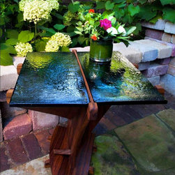 AuroraStone™ Midnight Traveler Accent Table - Reflective, sophisticated AuroraStone™  and warm, earthy teak combine in this unique accent table to bring grace and warmth to any living space, indoors or outdoors. This one-of-a-kind showpiece creates a welcoming place to indulge in coffee and a good book or to entertain friends over a glass of wine.