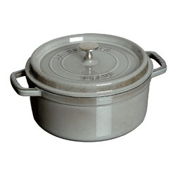 Staub - Staub Round Cocotte - 5.5 qt. - Graphite Gray - 1102618 - Shop for Baking & Roasting Dishes from Hayneedle.com! A favorite of professional chefs worldwide the Staub Round Cocotte - 5.5 qt. - Graphite Gray is a must-have for any well-stocked kitchen. This industrious pan features an extra-heavy lid that seals moisture in and dozens of well-placed spikes that continuously baste the food below ensuring your dish retains the full flavor of each ingredient. Clean up is easy. This pan is dishwasher-safe. Plus the high-quality enamel coating resists scratches and will never discolor.About Staub CookwareFrom professional chefs to home cooks people with a passion for cooking rely on Staub cookware. Combining the utility of cast iron with the latest technology available Francis Staub designed his first enameled pot in 1974 in the Alsace region of France. Known for performance style and durability Staub has become the benchmark for enameled cast-iron cookware. Ideal for braising searing roasting and caramelizing food Staub's signature pots - called cocottes - feature an enameled interior with a matte black finish. Resistant to rust chipping and cracking cocottes are available in round and oval shapes in a variety of sizes and colors. Just right for slow-cooking food Staub cocottes are designed to provide even heat distribution excellent heat retention and continuous self-basting. The inside of each heavy snug-fitting lid features a series of bumps (or self-basting spikes) to allow continuous natural basting by distributing moisture throughout for extra flavor and tenderness. In addition to its signature cookware which is perfect for serving at the table Staub also offers pans for frying sauteing grilling and roasting as well as a variety of teapots accessories and gourmet specialty items.