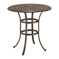HomeStyles - Floral Blossom Taupe Bistro Table - Assembly Required. Hand-applied gold specking sealed with a clear coat. 2-inch umbrella hole. Nylon glides on legs for stability. Stainless steel hardware. Dimensions: 42 in. W X  42 in. D X  40.5 in. HBy combining outdoor elements such as ceremonial and abstract floral designs, the Floral Blossom Round Bistro Table by Home Style is brought to life.  This table is constructed of cast aluminum in a powder coated taupe finish.  This outdoor table features hand-applied gold specking sealed with a clear coat for protection, attractive patterned table top that has 2-inch umbrella hole with black cap, and nylon glides on legs for stability.  Elegant design and sturdy construction, this piece is finished with stainless steel hardware.  Assembly required.  Size: 42w 42d 40.5h