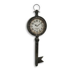 Antique Key Shaped Wall Mounted Clock  `Manchester Clock Co.` - The key is time, and in this case the time is key! This handsome antique key clock will enhance your office, living room or porch, and adds a lovely accent to any wall you choose. Made of metal, it has a movable handle at the top so it looks like it was just removed from a key ring, and measures 36 3/4 inches tall, 10 7/8 inches wide and 2 1/2 inches deep, and has an appealing distressed finish. The clock face is 6 3/8 inches in diameter, features quartz movement, and runs on 1 AA battery (not included). The face reads `Manchester Clock Co. London` and the numbers are eye catchingly bold so they are easy to read. This piece easily mounts to the wall with a single nail or screw by the hanger on the back. It makes a lovely gift, and will certainly be admired.