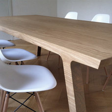 Modern Dining Tables by RKNL