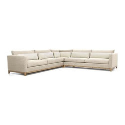 Taraval 3-Piece Sectional with Oak Base - Exposed hardwood base takes a sturdy stance in clean-lined sectional group cushioned in two tones of room-friendly neutrals. Slim track arms flank deep-seated cushions, seamlessly upholstered in a textural weave of putty cotton. Plump linen kidney pillows in stonewashed natural relax the back.