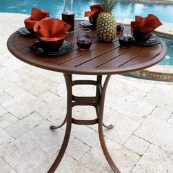 Hospitality Rattan - Slatted Aluminum Round Pub Table in Dark Bron - Traditional outdoor Aluminum 42 in. round bistro table. Finished in a powder coated Dark Bronze. Includes umbrella hole. Weather and UV resistant. Constructed of extruded Aluminum frame will not rust. Matches Chub Cay, Grenada, & Coco Palm Collections. Sturdy Aluminum legs for extra support. Overall: 42 in. W x 42 in. D x 39 in. H (55 lbs.)This outdoor slatted table incorporates a tubular extruded Aluminum frame that will not rust. The table requires assembly. The dining table tops are a special Aluminum slats powder coated in the Dark Bronze finish which will work for the Chub Cay, Grenada, Coco Palm collections. All outdoor slatted tables have an umbrella hole, even the pub table. The best feature with these tables is the fact that they eliminate the need for Glass outdoors. This item is a 42 in. round pub table.