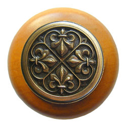 "Inviting Home - Fleur-de-Lis Maple Wood Knob (antique brass) - Fleur-de-Lis Maple Wood Knob with hand-cast antique brass insert; 1-1/2"" diameter Product Specification: Made in the USA. Fine-art foundry hand-pours and hand finished hardware knobs and pulls using Old World methods. Lifetime guaranteed against flaws in craftsmanship. Exceptional clarity of details and depth of relief. All knobs and pulls are hand cast from solid fine pewter or solid bronze. The term antique refers to special methods of treating metal so there is contrast between relief and recessed areas. Knobs and Pulls are lacquered to protect the finish. Alternate finishes are available. Detailed Description: The Fleur-de-lis means ""flower of the lily"" It was used to represent French royalty. It was said that the king of France Clovis who started using the symbol of the Fleur-de-lis because the water lilies helped guide him to safety and aided him in winning a battle. The design in the Fleur-de-Lis pulls is arranged in alternating positions of the Fleur-de-lis. These pulls are a great match for the Fleur-de-lis knobs which have the Fleur-de-lis pattern arranged in a circle. The different shapes of decorative hardware make the cabinet doors and drawers interesting to look at."