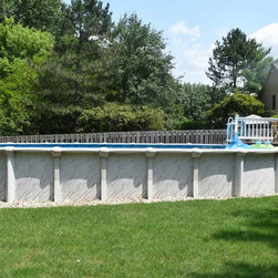 Above ground with patio furniture - This above ground pool is the perfect addition to any backyard along with the attached deck and patio furniture. This set-up is great for families to enjoy the sunshine for summers to come.