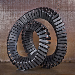 Sprung - This patinated steel sculpture that can be placed inside or out. It comes in a variety of shapes, finishes and sizes.
