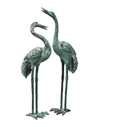 EttansPalace - Classic Asian Lost Bronze Crane Bird Sculpture / Fountain- Set of 2 - Large - Symbolize peace. Cast in the traditional lost wax bronze method and piped for fountain use. Like those seen in traditional English gardens, these Asian symbols of peace are lifelike, lost wax bronze statues with a verdigris patina. In a medium perfect for showcasing their graceful legs and exquisite, elongated necks, they are elegant in an entryway, a field of irises or a pond, and are piped for optional fountain use. These unparalleled sculptures cause their lightght-local Garden Shop aluminum cousins to pale in comparison. Choose from among three scaled sizes for your landscape or decor.