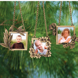 """Exposures - Family Tree Leaf Ornaments - Overview Transform your Christmas tree into a """"family tree"""" with these brass plated botanical photo ornaments. Clover represents luck, gingko symbolizes wisdom, and laurel signifies strength and victory. Slip a photo of a loved one who represents each characteristic into the frames. Makes a unique, symbolic gift.  Features Brass plated metal ornaments 24k gold plated Choose from three styles   Specifications  Laurel measures 2 1/8"""" wide x 3"""" high Clover measures 2 1/2"""" wide x 2 1/2"""" high Gingko measures 2 1/2"""" wide x 3"""" high"""