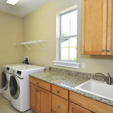 Mediterranean Laundry Room by Javic Homes