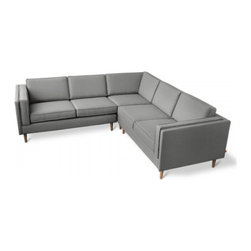 Gus* Modern - Adelaide Bi-Sectional, Varsity Charcoal - The Adelaide Bi-Sectional is a classic, symmetrical design that harkens back to Mid-century archetypes. Structured side cushions lend a vintage look, and provide added comfort. The solid, tapered-wood legs can be easily removed and reattached, allowing this sectional to fit through tight spaces. The sofa frame and legs are FSC®-Certified wood, in support of responsible forest management.
