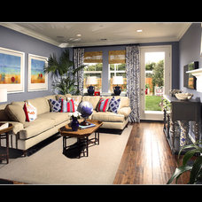 Tropical Living Room by JAG Interiors, Inc.