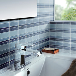 Tessera Meridian Cirrus - This glass tile is a collection of soothing blues laid out on a mesh in a midcentury modern scheme.