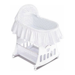 Badger Basket Bassinet-n-Cradle with Toy Box Base - The Badger Basket Bassinet-n-Cradle with Toy Box Base is both stylish and practical. Available in your choice of colors this bassinet will look sophisticated in any nursery. And this piece is extremely versatile--the Bassinet-n-Cradle can be used as a rocking cradle by rotating the caster wheels or you can remove it from the base to create a portable bed. As your child grows the base easily converts to a toy box. Hood cover bed skirt and mattress pad are included (machine-washable for easy maintenance). For use from birth until approximately 20 lbs. or until baby can push up/roll over unassisted. Badger Basket CompanyFor over 65 years Badger Basket Company has been a premier manufacturer of baskets bassinets bassinet bedding changing tables doll furniture hampers toy boxes and more for infants babies and children. Badger Basket Company creates beautiful and comfortable products that are continually updated and refreshed bringing you exciting new styles and fashions that complement the nostalgic and traditional products in the Badger Basket line.