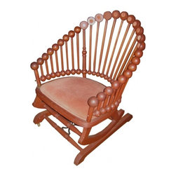 George Hunzinger Rocking Chair - This Lollypop rocker has excellent carved rosettes. Good brown oak patina. Hunzinger (the father of the folding chair) built an exceptional furniture enterprise in New York during Victorian times. Rocking mechanism was patente