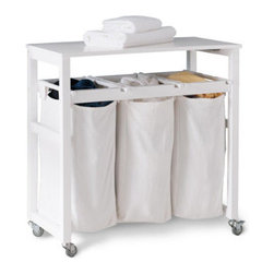 Grandin Road - Mobile Laundry Sorter - Bring order to the dirty little secret, otherwise known as your laundry room. The hinged folding surface lifts for easy access to laundry. Cotton canvas bags are removable. Four heavy-duty casters (two locking) make relocating a snap. Crafted from solid wood with a crisp white finish. Sort and fold laundry in a single compact space that rolls away, with our Mobile Laundry Sorter.  .  .  .  .  . Easy assembly.