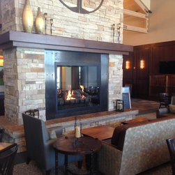 """Hyland Hills - Custom fireplace and professionally designed mantel with stone are the focal points for this new space. See thru 60""""x48"""" viewing"""