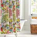 Woodland Shower Curtain - I like the thought of an plain white bathroom getting a major color boost through this flower-covered shower curtain.