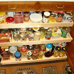 Full Extension Roll Out Shelves - Cabinets typically have two fixed shelves for storage.  With custom designed, built and installed roll out shelves, you can add shelves as needed for additional storage.  Each full extension roll out shelf holds up to 100 pounds, allowing you to store all your canned goods, bottled beverages and kitchen appliances without fear of a shelf collapse.