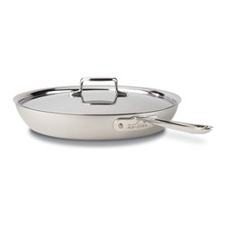 All-Clad - All-Clad d5 Brushed Stainless Steel 13 inch French Skillet w/Lid (BD551135) - The All-Clad d5 Brushed Stainless 13 inch French skillet is the largest French skillet in the d5 brushed stainless series. It has tall sides and a wide base so you can easily pan-fry lots of ingredients without letting food escape from the pan. This pan features even heating thanks to All-Clad's five-layer construction of steel and aluminum. Also, the cooking surface doesn't alter the flavor of any foods because it's made from 18/10 stainless steel. This d5 French skillet from All-Clad is made in the USA and comes with a lifetime warranty with normal use and proper care.
