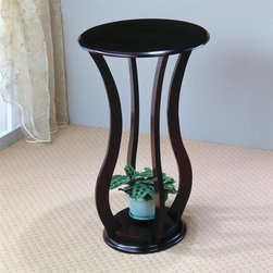 Coaster - Accent Plant Stand Table in Cherry Finish - Contemporary style. Curved base and round top. 18 in. Dia. x 28.5 in. H. WarrantyThe plant stand is the perfect ornamental or plant display for any vacant space in your home. This accessory provides a secure top to safely display your favorite plant.
