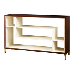 Nina Console - Baker Furniture - Nina makes quite an entrance. This is an example of how restraint doesn't work against luxury, but it does raise the stakes for design. Thomas Pheasant conceived the Nina as a signature form. It is shallow, open, and light. The graphics of the symmetric but intersecting shelves are the design. The outer mahogany frame almost disappears-allowing an inner bronze border further punctuated with classical rivets. Tapered bronze legs, dressed with an anklet, provide the height of what some will find an exotic vision of refinement.