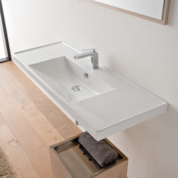 Scarabeo - Rectangular White Ceramic Self Rimming or Wall Mounted Bathroom Sink - Rectangular white ceramic self rimming or wall mounted sink. Stylish sink comes with overflow and no hole, one hole or three hole options. Made in Italy by Scarabeo. Made out of white ceramic. Contemporary design. Counter space on both sides. Includes overflow. Standard drain size of 1.25 inches. ADA compliant. Because the sink has multiple installations, the back side is not glazed.