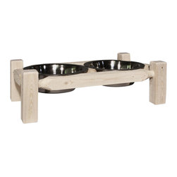 """Montana Woodworks - 23 in. Pet Feeder - Includes two, three quart embossed stainless steel bowls. Handcrafted. Trim pieces are sawn square. Heirloom quality. Constructed using the tried and true mortise and tenon joinery system. Durable build and fit. Edge glued panels. Solid lodge pole pine. Made from solid grown wood and timbers. Ready to finish. Made in USA. No assembly required. 23 in. W x 13 in. D x 7 in. H (8 lbs.). Warranty. Ready to FinishMontana woodworks, the largest manufacturer comes the all new homestead collection line of furniture products. Add rustic decor to your pets dinnertime! This delightful pet feeder is the perfect gift for a man or woman's best friend. This unique pet feeder is sure to elicit """"oohs"""" and """"aahs"""" from family, friends and best friends. Don't have a pet? Use this """"feeder"""" to satisfy the cravings of your other friends at parties and events. Each piece signed by the artisan who makes It."""