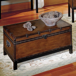 "Steve Silver - Voyage Trunk - Create a classic style with the brown Voyage trunk, cocktail, and end tables. This gorgeous coffee table has a rectangle shape and features a trunk style. With square legs this trunk has leather like finish in a rectangle shape and nail head trim around the bottom and the opening with a metal flap lock. The top is smooth with decorative leather like trim with straps and metal pulls on the sides. This Voyage dark brown coffee and end table will bring decorative charm to any home decor.;Features: Multi-Step Antique Cherry Finish;Contemporary Style;Corner Blocked Construction;Tongue and Groove Joints;Storage Trunk Cocktail;Weight: 81.5 lbs.;Dimensions: 44""L x 24""W x 21""H"