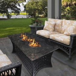 """California Outdoor Concepts LaCosta Del Rio 54 x 28 in. Rectangle Fire Pit Table - The very name of the California Outdoor Concepts LaCosta Del Rio 54 x 28 in. Rectangular Fire Pit Dining Table describes the Spanish influence shaping the fire that flows down its center. Give your next outdoor banquet or intimate dinner for two that wow factor with this luxurious outdoor piece featuring a uniquely designed fire bowl! """"""""Del Rio"""""""" means """"""""to or from the river"""""""" and the low-level blaze rising from the table's surface winds like a stream cutting through the countryside. Of course the table itself is also quite impressive. The top is artfully designed from polished granite that rests atop a sturdy aluminum base with curved edges and open-weaved sides that surround a stainless steel burner capable of emitting up to 83 000 BTUs. For a finishing touch customize your table with either realistic gas logs and lava rocks that cover the burner or your choice of colorful fire glass. Runs on propane and/or natural gas conversion kit for natural gas is included. About California Outdoor ConceptsCalifornia Outdoor Concepts builds their fire pits and accessories exactly where it would seem - in the sunny climate of idyllic California. By living the lifestyle they sell this small company is able to develop some of the most sophisticated beautiful and practical designs for outdoor socializing. There are no assembly lines at the COC production facility - each piece is handmade and checked for perfection. When you're ready to heat things up in your backyard trust in the true California way."""
