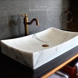 """Living'ROC - 27"""" White Marble Stone Bathroom Vessel Sink  - TOJI WHITE - TOJI WHITE is a 27'x16'X5' genuine interior DECO Guangxi White marble stone. The 'Exceptional' cut in the block without any comparison with plastic and other chemical resin market often unaffordable.  You will definitely not let anyone feel indifferent with this 100% natural stone unique in the US and exclusively available on Living'ROC.net.  Feel free to click on our facebook portfolio page to inspire yourself with our clients' projects...Simply our living'ROC style. Imagine creating a beautiful bathroom made from White polished marble. Discover the well-being and the restful feeling TOJI WHITE can give you. Its slim and sleek lines invite calm and serenity. Its four curved edges allow a large amount of water. This creation will give your bathroom a stunning look. Its grey color and its irresistible look make it one of the most incredible basins of the moment.At LivingRoc we have chosen the most beautiful stones. All our bathroom sink are made from high quality pure genuine materials that will last for years to come. Granite Basalt Marble are materials perfectly adapted to bathroom use. TOJI WHITE is the creation of a combined group of talented masons dedicated to the idea of creating bathware made from natural material which is environmentally friendly. Waterproofed TOJI  WHITE is ready to use sitting on a vanity counter top. Our creation is delivered without an overflow drain (not included) - every US drains models you can find on the market will fit perfectly on Living'ROC vessel sink. This model is ready to use over the countertop.The photos you see online have been taken with extreme care by our Founder CEO - Florent LEPVREAU because without them we would not be one of the natural stone business key player of the online European continent. Once you have encountered the product in your home you will always have pure happiness for the love of the materials. It will be beyond your expectatio"""