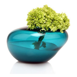 Gala Teal Vase - Float a fresh bouquet of your favorite blooms in this cool, modern vase. Its uneven form seems to glide free-form through space, making an interesting complement to structural blossoms like freesia or hydrangea.