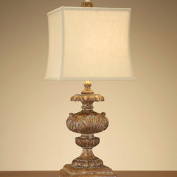 Country Pine Finial Lamp - A box shade with hourglass-shaped lines tops off the upscale farmhouse elegance of this carved wood lamp.  Rustically finished but detailed with fluted petals, acanthus leaves, and similar elements of neo-Classical formality, the luxurious table lamp has shades of whitewash and tones of rich gold over its natural weathered pine base color.  Regardless of the style or wood tones in your decor, the eclectic combination cannot fail to please.