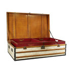 """Inviting Home - Polo Club Trunk Coffee Table (small) - Polo Club trunk coffee table; 28-3/8""""D x 48""""W x 21""""H; Polo Club trunks feature a strong wood frame covered with distressed painted canvas and steamer-varnished hardwood slats. Trunk coffee tables have solid hand made brass hardware in antique bronzed finish. Every trunk carries two sliding trays painted in signal-red. Polo Club trunks are ideal as coffee tables combining storage with functionality and design! Roomy and strong these trunks are heirlooms for generations to come. Luxury on the Go! Once there was a time when porters took care of luggage. Appearing elegant and decorative an army of trunks were loaded into the baggage car or the ship's hold. Royalty and upper-class in the Belle Epoque traveled with specialized trunks. Armoires bars libraries and of course hat-trunks and trunks for the prize-winning poodle. Antique French trunks with famous brand names now catch exorbitant sums at auction. Except for the logo our trunks are closely inspired by the old classic travel trunks of yore."""
