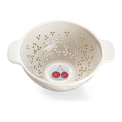 Fruit Colander - Cherry - Charming, colorful illustrations of early summer's most iconic fruit adorn the bottom of the Cherry Fruit Colander, a delightful and useful ceramic piece for practical use or handsome display. Whether used a centerpiece or cachepot, or kept by the sink for rinsing seasonal produce, this weighty colander with its side handles has a steady year-round charm.