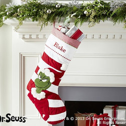 Dr. Seuss's The Grinch Quilted Stocking - Who can resist the Grinch? I would love this for a little one who loves Dr. Seuss and the Grinch — or maybe even for a real-life Grinch.