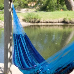 Island Bay XXL Hand Woven Caribbean Stripe Thick String Hammock - Sometimes you just need a good place to relax and unwind. The XXL Hand Woven Caribbean Stripe Thick String Hammock lets you do that alone or with whole family. Surprisingly lightweight, this hammock is capable of holding three plus people, and has an impressive weight capacity of 750 lbs. Thick, cotton strings give this hammock its strength and its comfort. It will wrap you all up in complete bliss. You should use this hammock with a stand designed for use with non-spreader bar hammocks or with tree straps. In the off season, it bundles up nicely for compact storage. We recommend: The XXL Thick String Mayan Hammock is most comfortable lying alone or lengthwise. People of lower weight and smaller size, or groups of people can lie in the Dangerously Comfortable position, across the width of the hammock.