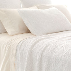 Kerala White Matelasse Coverlet - Life is but a dream, or so it seems with the Kerala White Matelasse Coverlet. The ultra-soft stonewashed cotton boasts a woven diamond pattern that is at once subtle yet distinctive, lending the coverlet a textured beauty that calls to mind the airiness of cotton white clouds. The easy drape imparts a casual yet refined finishing touch to your bedscape.