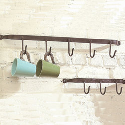 "Iron Hook Wall Rack - Understated rustic design makes this wall rack perfect for clearing clutter in your home. Use to hang everything from coats and hats in the hallway to soup and coffee mugs in the kitchen. These sturdy iron and metal racks are easy to install. This line features products that have been hand crafted in a variety of cottage industries around the world. Small differences in shape, size, surface, and finish should be expected and lend individuality and charm to each piece. Dimensions: (3""hook) 16""w x 4""h (5""hook) 30""w x 4""h"