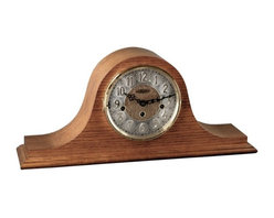Hermle Clocks - Laurel Westminster Chime Mantel Clock in Classic Oak - A Westminster medley and wavy profile highlight this Laurel collection mantel clock. It has a classic crested profile, accentuated with a warm oak finish. Two tone dial features embossed Arabic numerals for easy recognition. Beveled base completes the look. Classic Oak finish. Diamond turned chapter ring dial. Embossed Arabic numerals. Shut-off through the dial. 8-Day Brass key-wound mechanical strike movement. Plays Westminster melody. Listen to the chimes!. 19.75 in. W x 4.38 in. D x 8.88 in. H
