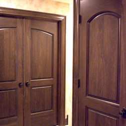 Custom Poplar Continental Interior Doors - Custom poplar interior two panel continental closet door and two panel double bedroom door with custom casing and Emtek oil rubbed bronze rope knob door hardware and hinges.