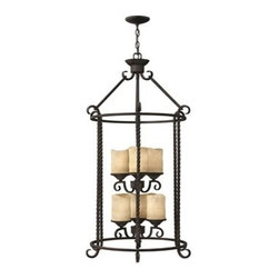 Hinkley Lighting - Hinkley Casa Olde Black Six-Light Mini-Chandelier - Casa makes the most of its fine details- individually unique antique scavo glass twisted wrought iron and hand-forged scrollwork in an Olde Black finish complete its rustic-chic appeal with a Southwestern flair.Under four generations of family leadership Hinkley Lighting has transformed from a small outdoor lantern company to a global brand intent on bringing you the best in style quality and value. LIFE AGLOW: That's their mantra and they take it seriously. By welcoming their products into your home they become part of your family's everyday life illuminating small moments and big occasions. They understand your home is so much more than a physical place. It's an emotional space designed by you so they are committed to keeping your 'Life Aglow' with stylish state-of-the-art lighting. Their products are the ultimate combination of style and substance. They are constantly developing new technologies to make their fixtures even more energy efficient. Hinkley recently upgraded their LED to cutting-edge high lumen output integrated solutions and they give you hundreds of energy-efficient styles to choose from. Even their Cleveland-based world headquarters employs high energy saving standards with low VOC materials and a variety of eco-smart applications into the design to make an earth-friendly work environment for their Hinkley family. Hand crafted fixtures luxe finishes artistic details and quality materials go into the design of every product they make. They embrace the philosophy that you can merge together the lighting furniture art and accessories you love into a beautiful environment that defines your own personal style.