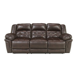 Signature Design by Ashley - Randon Reclining Sofa in Mahogany - Easy-going comfort and style will make this dual Randon Reclining Sofa by Ashley your new go-to place to relax. Settle into the comfort of the pillow arms and plush divided back as you unwind after a long day. The brown vinyl has a faux leather look that is contemporary and versatile for any living room, family room, or den.