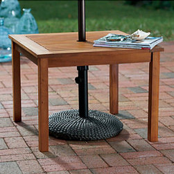 "Improvements - Eucalyptus Umbrella Table - This patio side table holds an umbrella to provide shade by the pool or on your deck. The Eucalyptus Umbrella Table has a slatted design that allows water to drain quickly. Made of weather-resistant hardwood, the Eucalyptus Umbrella Table will provide many years of service. Our Euclayptus Umbrella Table makes the ideal sidekick for deck or patio. Crafted of solid eucalyptus, a renewable tropical hardwood, this patio table is weather-resistant and durable, with a hole in the center for your patio umbrella. Use the Eucalyptus Umbrella Table by a chaise or chair to provide shade and a resting spot for snacks. The Eucalyptus Umbrella Table is designed to coordinate with our patio furniture, in your choice of finishes: espresso or natural oil-treated finish that will gradually age to a soft gray if left unprotected. The Eucalyptus Umbrella Table is 24""Sq. x 18""H. When used with a patio umbrella, we recommend you use an umbrella base (sold separately) for stability.Benefits of the Eucalyptus Umbrella Table:    For easy steps on how to clean & maintain beautiful patio furniture, check out our Outdoor Furniture Care article."